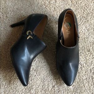 CK black dress shoes with gold accent. Gently used